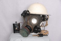 Image of WWII GAS MASK (RESPIRATOR)  WITH MICROPHONE AND WARDENS HELMET, 1938