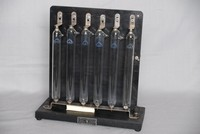 Image of 6  GRIFFIN AND TATLOCK  VACUUM TUBES IN A RACK, 1950's