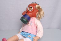 Image of WWII MICKEY MOUSE GAS MASK ON TODDLER